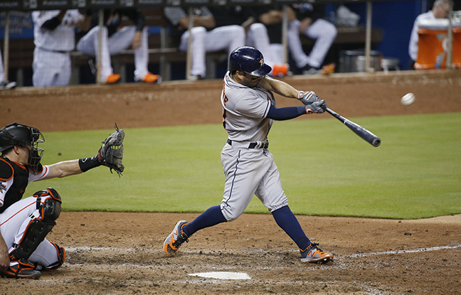 Houston Astros' Jose Altuve hits a home run during the ninth inning of a baseball game against the Miami Marlins, Monday, May 15, 2017, in Miami. The Astros defeated the Marlins 7-2. (AP Photo/Wilfredo Lee)