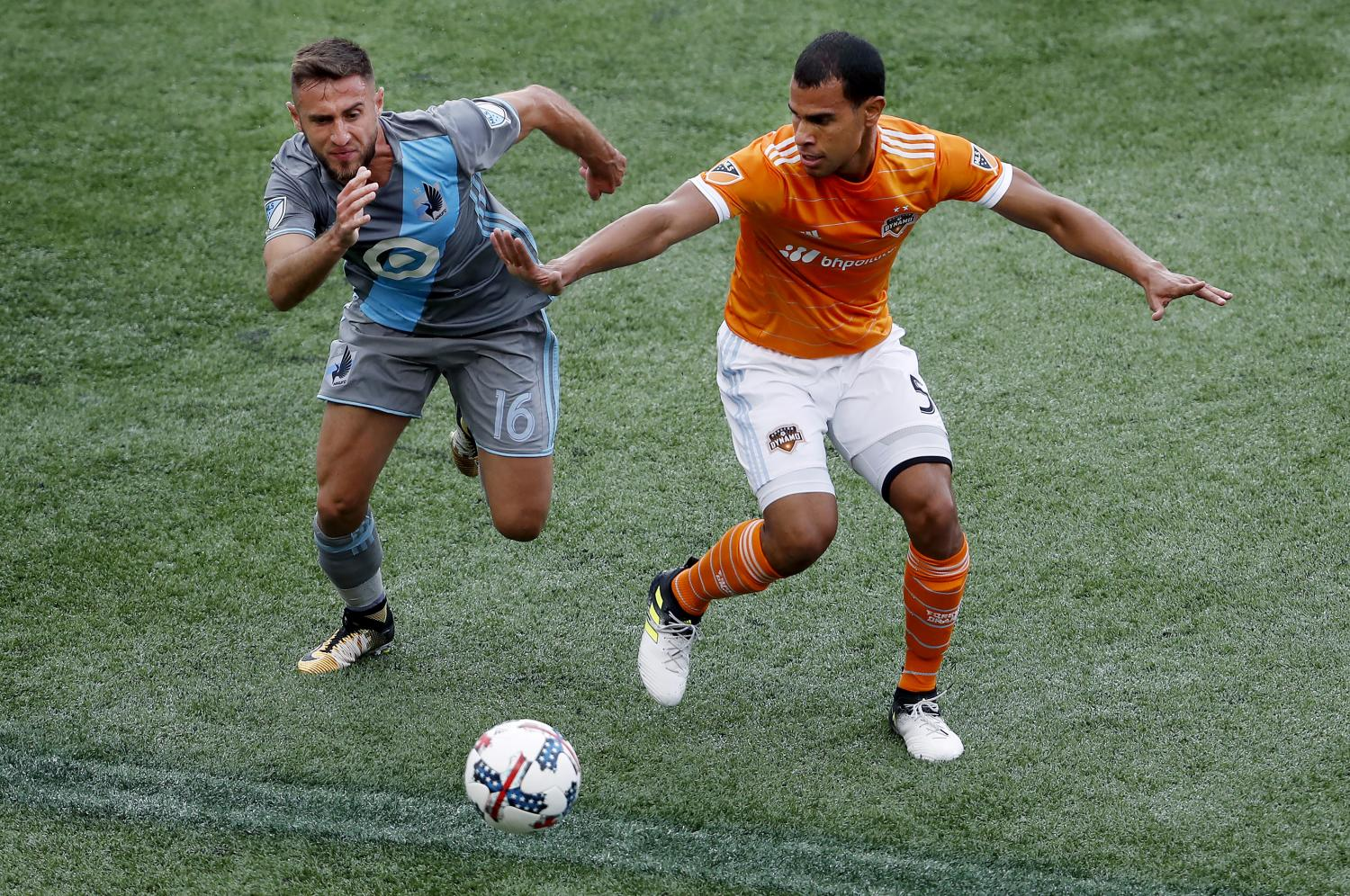 Minnesota United's Bashkim Kadrii (16) and Houston Dynamo's Juan Cabezas (5) vie for the ball. (Carlos Gonzalez/AP)