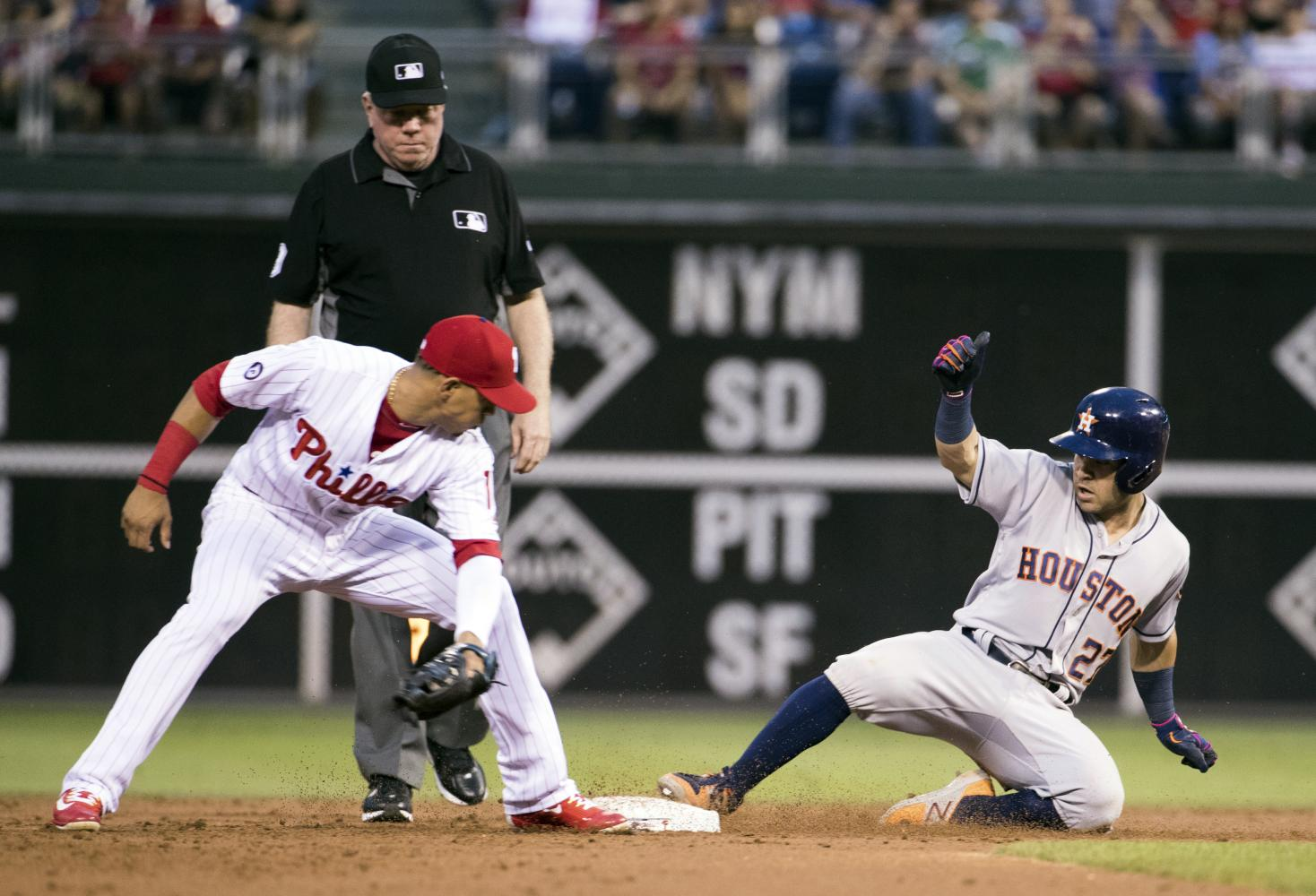 Jose Altuve slides into second bases on one of his two doubles of the night.(AP Photo/Chris Szagola)