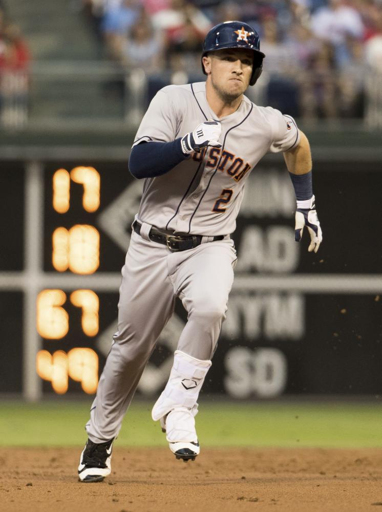 Alex Bregman running to third in the 3rd inning. (AP Photo/Chris Szagola)