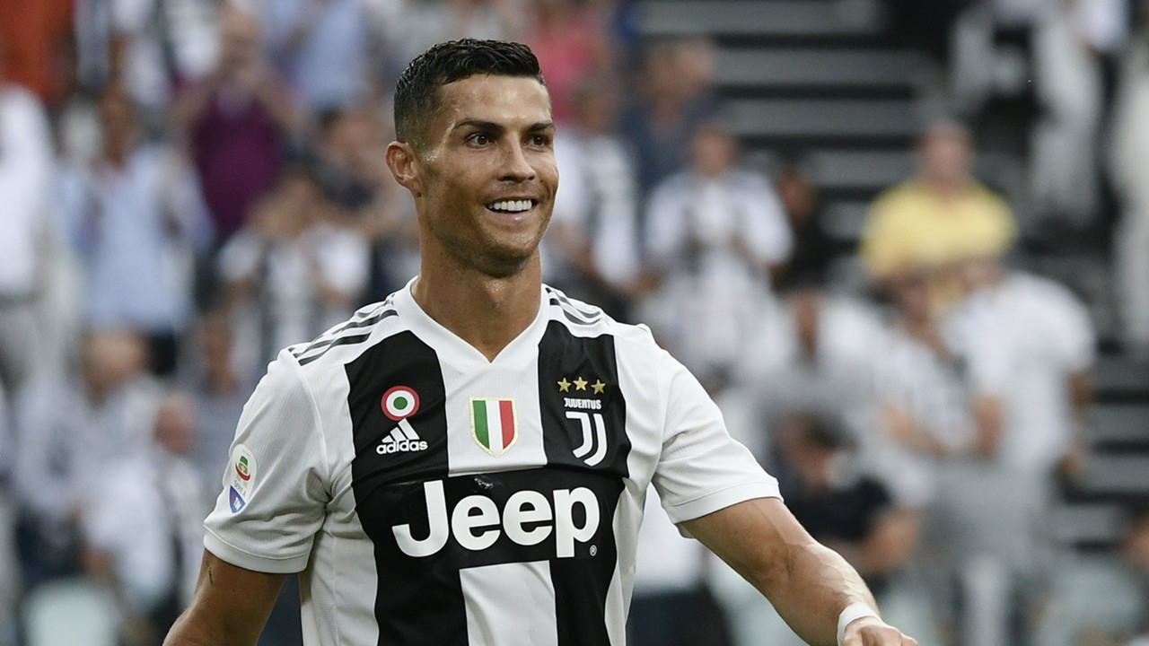 Ronaldo smiling while playing against Lazio at a Juventus Serie A home game. This was his first home game with Juventus after leaving Real Madrid.
