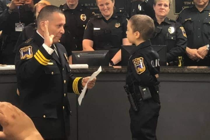 Fighting the Bad Guys: Cancer patient sworn in as cop for a day