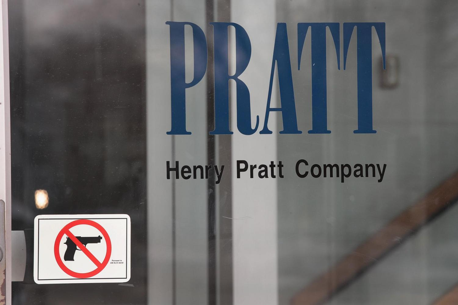 A picture on the entrance of the Henry Pratt Co. shows that guns aren't allowed in the building.