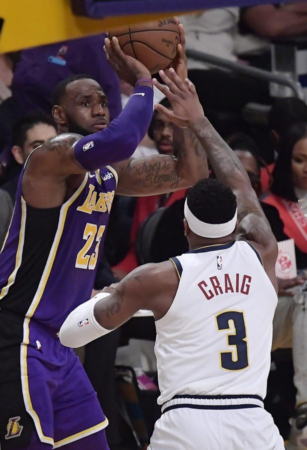 Los+Angeles+Lakers+forward+LeBron+James%2C+left%2C+shoots+and+scores+as+Denver+Nuggets+forward+Torrey+Craig+defends+during+the+first+half+of+an+NBA+basketball+game+Wednesday%2C+March+6%2C+2019%2C+in+Los+Angeles.+With+that+basket%2C+James+tied+Michael+Jordan+on+the+NBA+career+scoring+list.+%28AP+Photo%2FMark+J.+Terrill%29