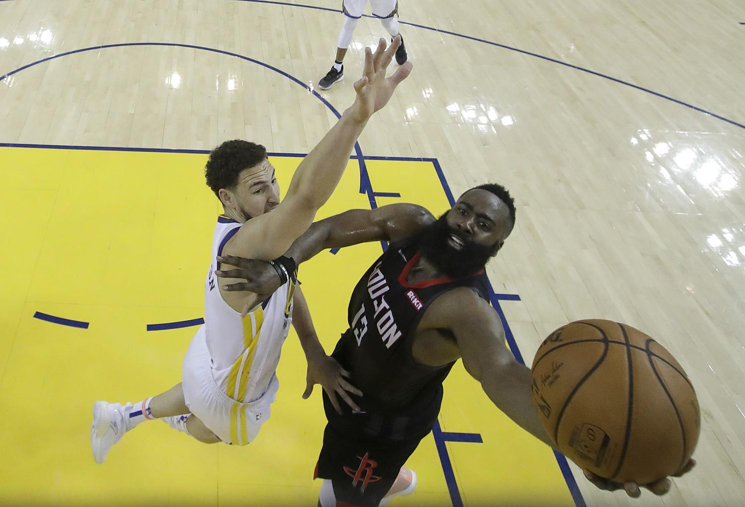 Houston Rockets guard James Harden, right, shoots against Golden State Warriors guard Klay Thompson during the second half of Game 1 of a second-round NBA basketball playoff series in Oakland, Calif., Sunday, April 28, 2019.