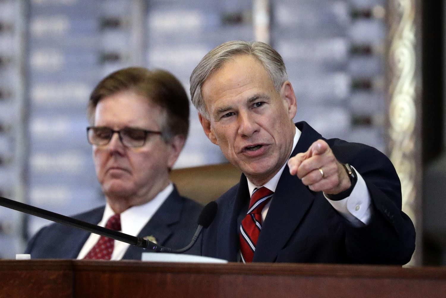 FILE - In this Feb. 5, 2019 file photo, Texas Gov. Greg Abbott, right, gives his State of the State address as Lt. Gov. Dan Patrick, left, listens in the House Chamber in Austin, Texas. Texas' tough stance on marijuana as the drug becomes increasingly legal elsewhere in the U.S. has grounded a bipartisan push in the state to decriminalize minor offenses — a change the Texas GOP platform has come around to endorsing, but not Republican Gov. Greg Abbott.