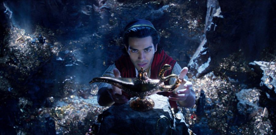 This image released by Disney shows Mena Massoud as Aladdin in Disneys live-action adaptation of the 1992 animated classic Aladdin. (Disney via AP)