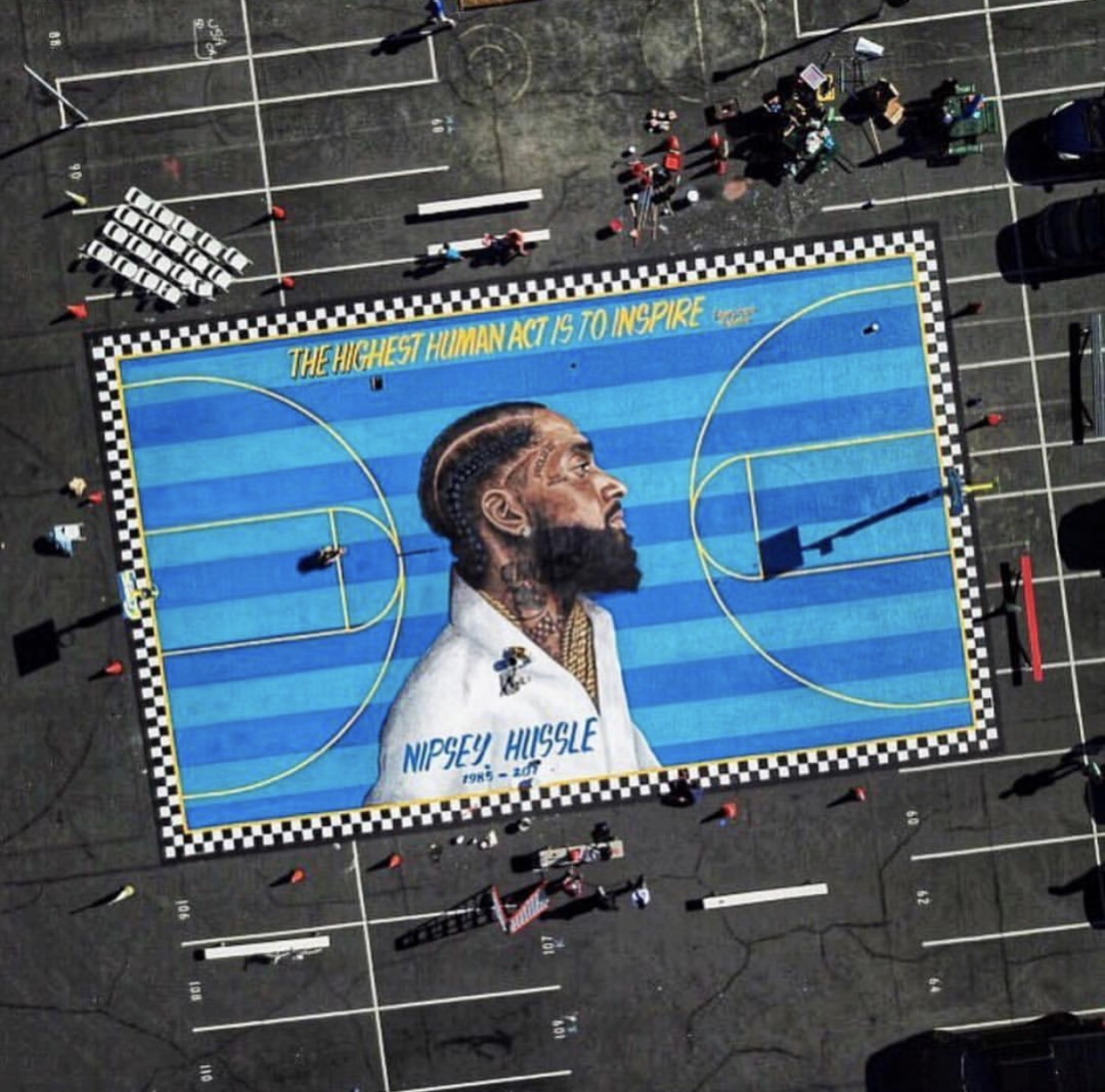 """The Marathon Continues"" – a basketball court mural unveiled to the public in the Crenshaw neighborhood of Los Angeles on April 14 by Nipsey Hussle's family. The mural, painted by artist Gustavo Zermano is located within blocks away from his memorial."