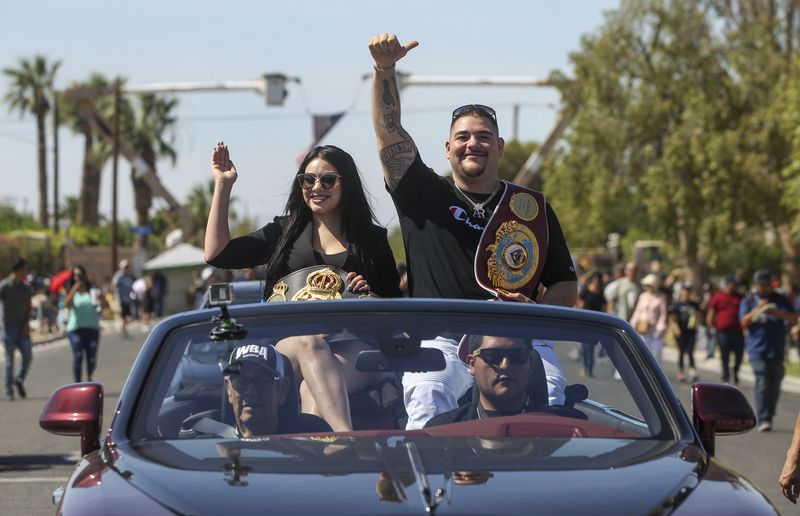 Heavyweight+boxing+champion+Andy+Ruiz+Jr.+and+his+wife%2C+Julie%2C+wave+to+a+cheering+crowd+Saturday+during+a+parade+honoring+him+in+his+hometown+of+Imperial%2C+California+