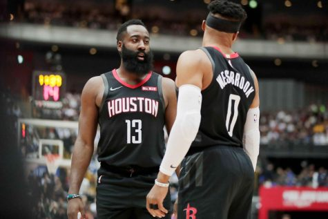 Houston Rockets' James Harden, left, talks to Russell Westbrook during the first half of an NBA preseason basketball game against the Toronto Raptors Tuesday, in Saitama, near Tokyo.