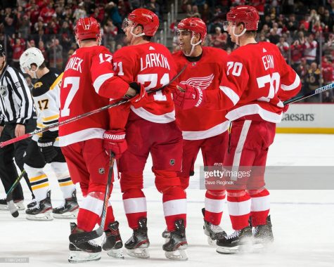 DETROIT, MI - FEBRUARY 09: Andreas Athanasiou #72 of the Detroit Red Wings celebrates his second goal of the third period goal with teammates Filip Hronek #17, Dylan Larkin #71 and Christoffer Ehn #70 during an NHL game against the Boston Bruins at Little Caesars Arena on February 9, 2020 in Detroit, Michigan. Detroit defeated Boston 3-1. (Photo by Dave Reginek/NHLI via Getty Images)