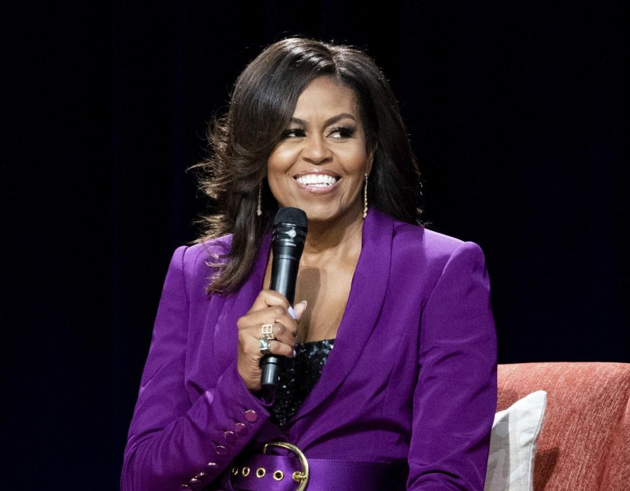This+May+11%2C+2019+file+photo+shows+former+first+lady+Michelle+Obama+during+%22Becoming%3A+An+Intimate+Conversation+with+Michelle+Obama%2C%22+in+Atlanta.+Netflix+says+a+documentary+portrait+of+Michelle+Obama+titled+%E2%80%9CBecoming%E2%80%9D+will+premiere+on+its+streaming+service+next+week.+It+chronicles+her+34-city+book+tour+in+2018-2019+for+her+memoir+%E2%80%9CBecoming.%E2%80%9D+%28Photo+by+Paul+R.+Giunta%2FInvision%2FAP%2C+File%29