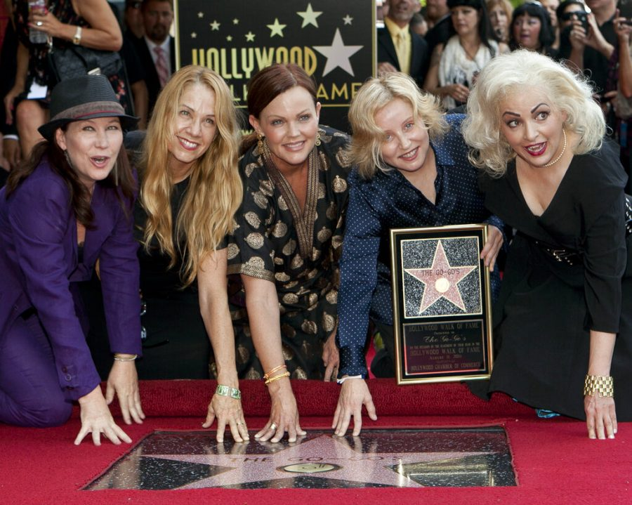 The female band The Go-Go's, from left, Kathy Valentine, Charlotte Caffey, Belinda Carlisle, Gina Schock and Jane Wiedlin pose at their star on the Hollywood Walk of Fame in Los Angeles on Aug. 11, 2011. The band made this year's list of nominees to the Rock and Roll Hall of Fame. The class of 2021 will be announced in May. (AP Photo/Damian Dovarganes, File)